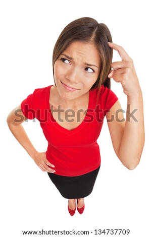 Contused thinking woman. Funny high angle studio portrait of a bewildered and confused woman scratching her head as she seeks a solution isolated on white background. Multiethnic female model. - stock photo