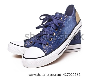 Convenient for sports mens sneakers in blue thick fabric on a white background. - stock photo