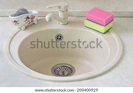 Convenient sink for ware from metal ceramics with convenient to plums from stainless steel. - stock photo