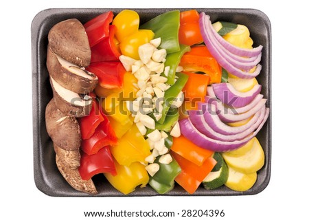 Convenient store prepared stir fry vegetables on a styrofoam tray. Isolated. (Portobello mushrooms, peppers, garlic, onion, squash). - stock photo