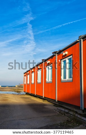 Conventional shipping containers housing on a bright sunny day - stock photo