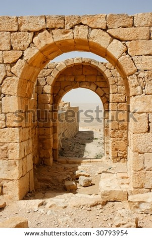 Converging ancient stone arches