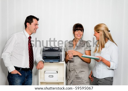 Conversation among several employees in an office - stock photo