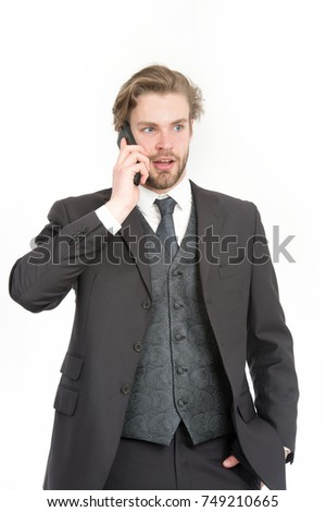 Conversation and new technology. Business fashion and success. Businessman or ceo in black jacket. Manager with beard on serious face. Man in formal outfit with mobile phone.