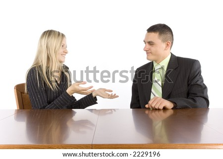 conversation of two businesspeople at the table - stock photo