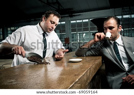 conversations about coffee between barista and businessman - stock photo