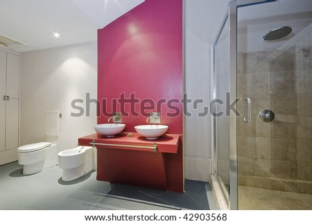 conversion bathroom with two separate sinks and shower corner - stock photo