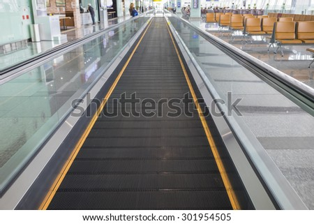 Conveyor bell for moving people in modern airport - stock photo