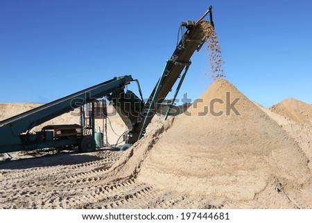 Conveyor belt dumping clean screened sand for building - stock photo