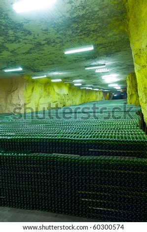conveyor belt in a factory which produces champagne - stock photo