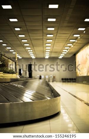 Conveyor belt in airport - stock photo