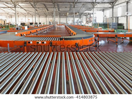 Conveyor Roller System For Sorting in Distribution Warehouse - stock photo