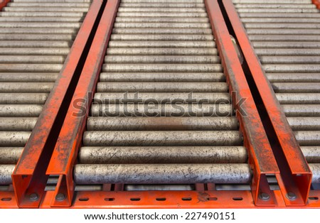 Conveyor rollers transport system for crates in factory - stock photo