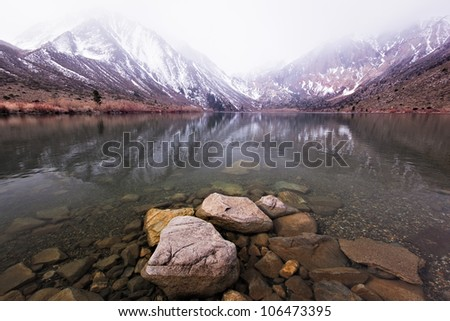 Convict Lake in the Eastern Sierras enjoys a dusting of snow for sunrise. - stock photo