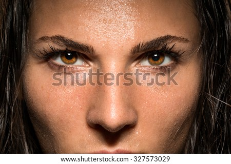 Conviction focused determined passionate confident powerful eyes stare intense athlete exercise trainer - stock photo