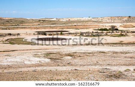 Coober Pedy golf course arid lunar landscape, Mad Max filmed here, tees are oiled sand - stock photo