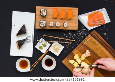 Coocing Sushi, hands - mooving blur - stock photo