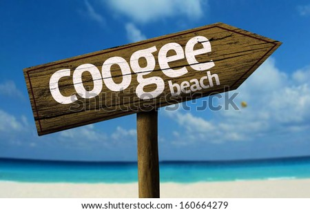 Coogee Beach on New South Wales, Australia wooden sign with a beach on background - stock photo