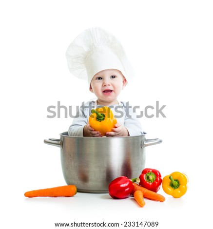 cook baby sitting inside big pan with healthy food isolated on white - stock photo