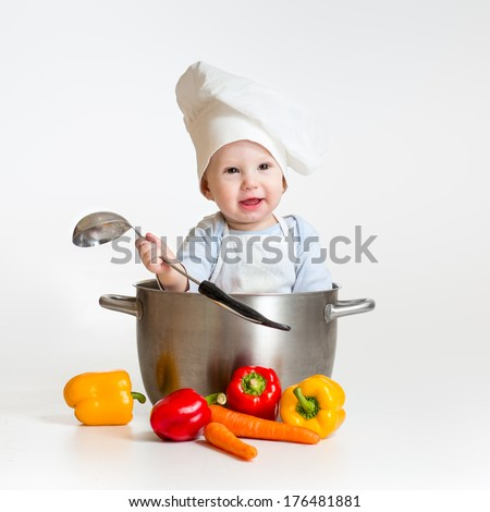 cook baby sitting inside pan with healthy food - stock photo