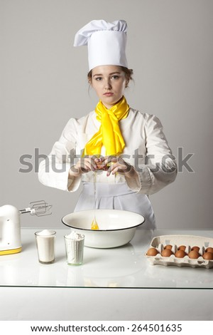 Cook breaking egg and cooking tasty pie - stock photo