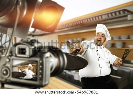 Cook chef in studio and camera with lamps
