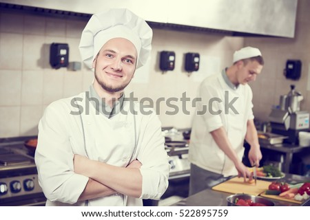 cook chef Portrait in restaurant kitchen