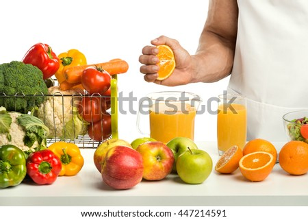 cook concoction by hand freshly squeezed orange juice, on whie background, isolated - stock photo