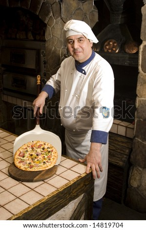 Cook cooking on the kitchen. - stock photo