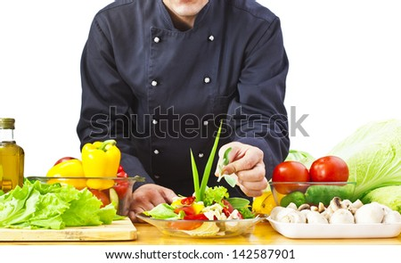 cook cooking vegetables at kitchen - stock photo
