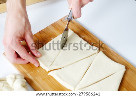 Cook cutting dough for home made baking - stock photo