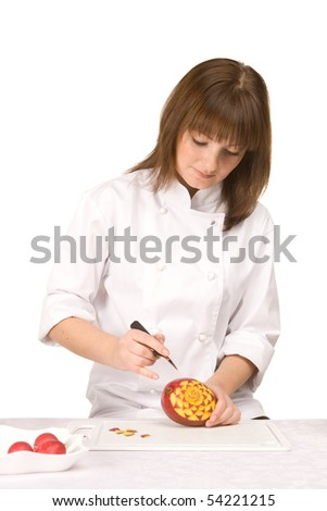 cook girl makes carving a mango - isolated on white background