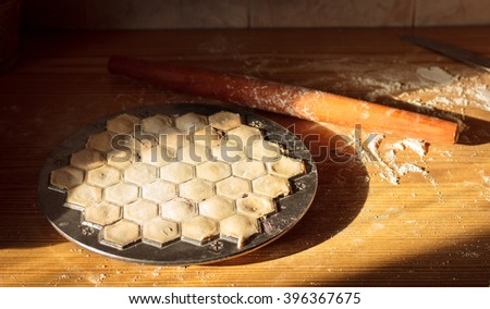 cook hands homemade ravioli with meat - stock photo