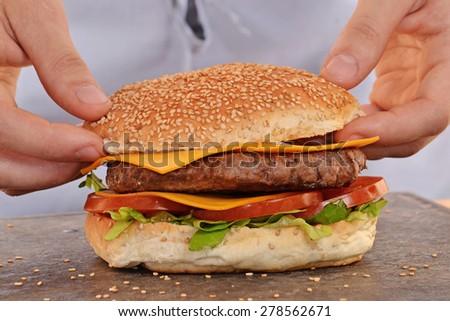Cook hands preparing and making hamburger. - stock photo