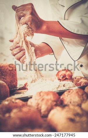 Cook hands preparing dough for homemade pastry - stock photo
