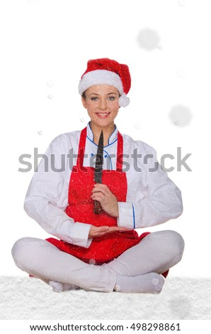 Cook in Santa Claus hat, yoga, knife under snow on white background