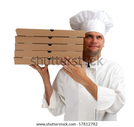 cook in white uniform and hat with boxes of pizza - stock photo