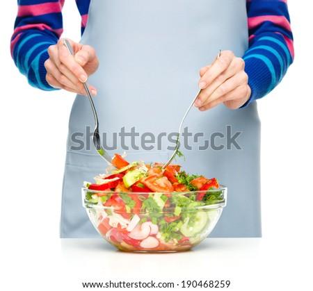 Cook is mixing fresh summer salad, closeup shoot - stock photo