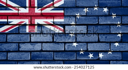 Cook Islands flag painted on old brick wall texture background - stock photo