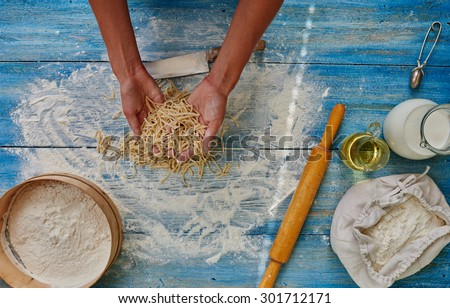Cook Italian restaurant spaghetti made by hand from the test - stock photo