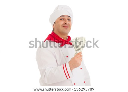 cook man holding fan of dollars wearing white uniform in the studio over white background. isolated