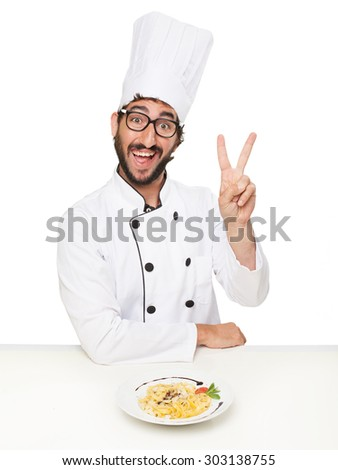 cook man victory sign with pasta