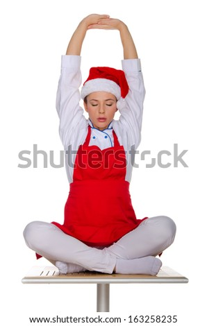 Cook meditating in a red apron and cap isolated on white