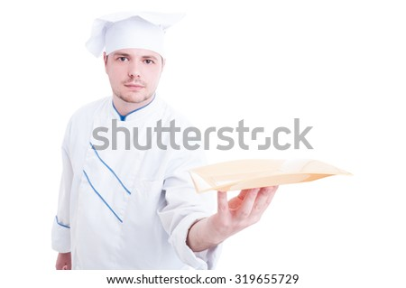 Cook or chef holding and presenting an empty plate with copy space for advertising - stock photo