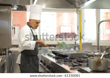 Cook preparing food in a restaurant kitchen