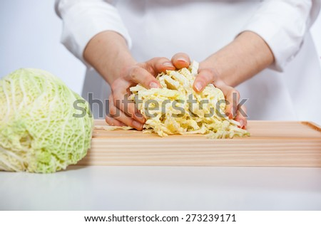 Cook's hands preparing salad, closeup shot of hands - stock photo
