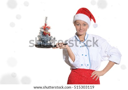 Cook with Christmas tree in pan covered with snow isolated on white