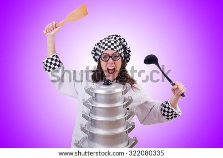 Cook with stack of pots on white - stock photo