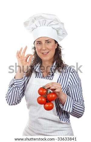 Cook woman making and deliciousness gesture and holding a bunch of tomatoes isolated on white background - stock photo