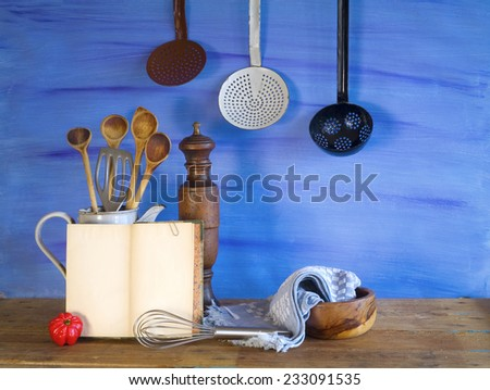 cookbook and kitchen utensils, free copy space - stock photo
